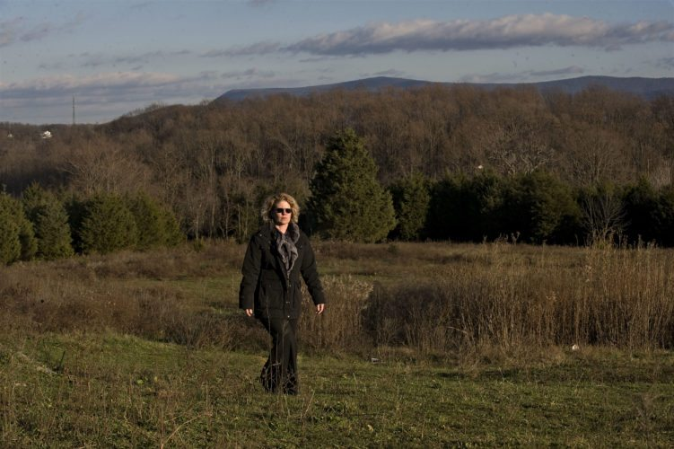 Tabitha Whitacre, development coordinator/research and advancement for Shenandoah Valley Battlefields Foundation, walks along this 24-acre site of the Fishers Hill Battlefield near Toms Brook, which the foundation is planning to purchase through state and federal grants.  Rich Cooley/Daily